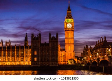 Big Ben and Houses of parliament at twilight on Westminster bridge in London, UK. Lit building at night, nightlife photography.
