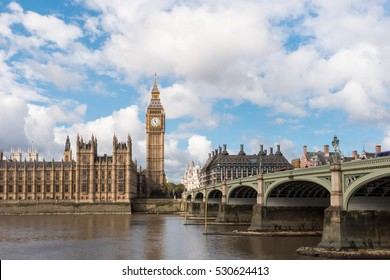 The Big Ben, the Houses of Parliament and Westminster Bridge with blue sky in London, England, UK