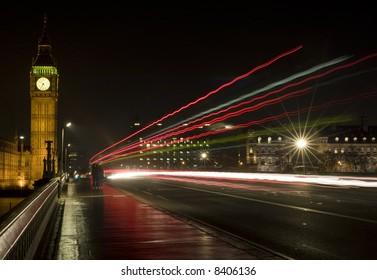 Big Ben, London, England shot at night across Westminster Bridge