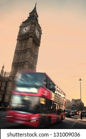 Big Ben and London transport - double deckers and taxis heading towards Westminster Bridge in the afternoon.