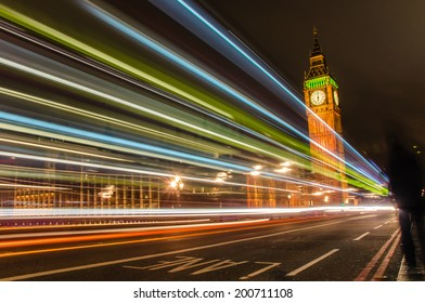 Big Ben at Night with Light Trails Left by Passing Cars and Buses
