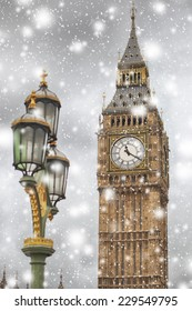 Big Ben on a winter snowy day against cloudy sky