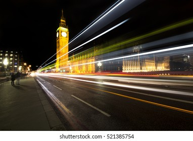 Big Ben, one of the most important symbols of London, in a scene by night with the cars lines passing by, long exposure photography