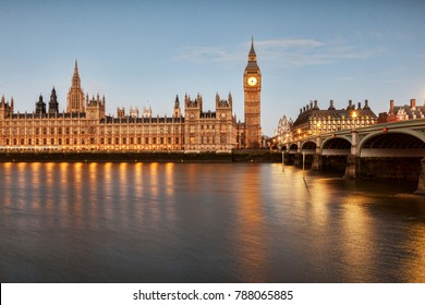 Big Ben, the Palace of Westminster and Westminster Bridge, reflecting in the River Thames.