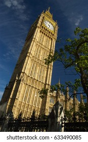 Big Ben and the Palace of Westminster, landmark of London, UK. House of Parliament in London on a bright day. English or British flag, symbol and architecture. Victoria Tower and Parliament square.