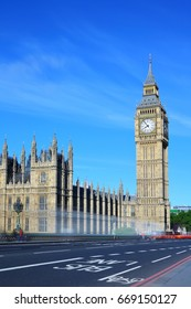 Big Ben and Palace of Westminster viewed from Westminster Bridge, with motion blurs of passing vehicles, London, United Kingdom