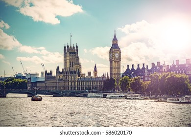 Big Ben, Parliament Building and Westminster Bridge on River Thames, Vintage filtered style with lens flare, London, UK, Europe