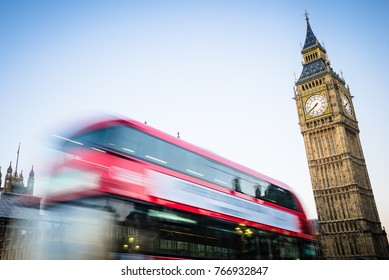 Big Ben and red bus in motion