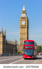 Big Ben with a red double-decker bus in London, UK