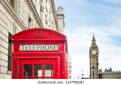 Big ben and red phone cabin in London.