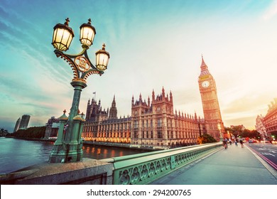 Big Ben seen from Westminster Bridge, London, the UK. at sunset. Retro street lamp light. Vintage