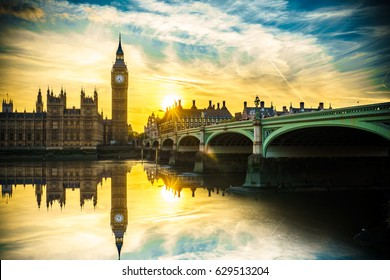 Big Ben with sun flare and reflection at sunset in London,UK