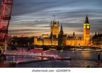 Big Ben and Thames riverside at dusk with lights