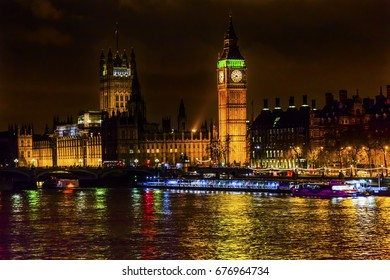 Big Ben Tower Houses of Parliament Thames River Westminster Bridge Night Westminster London England.  Named after the Bell in the Tower. Has kept exact time since 1859.