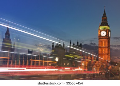 Big Ben at twilight with traffic lights - shot from Westminster Bridge
