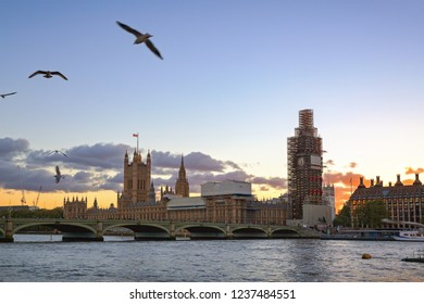 Big Ben under construction and Westminster Bridgein sunset