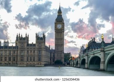 Big Ben and Westminster Bridge at dusk, London, UK. Brexit clouds over London