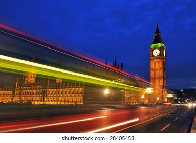 Big Ben from Westminster bridge with light trail from a London bus.