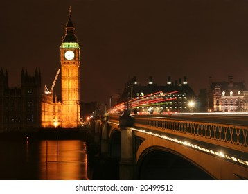 Big Ben and Westminster bridge at night, with trail of lights due to long exposure
