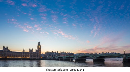 Big Ben and Westminster Bridge and Parliament with colorful clouds at dusk, London, UK