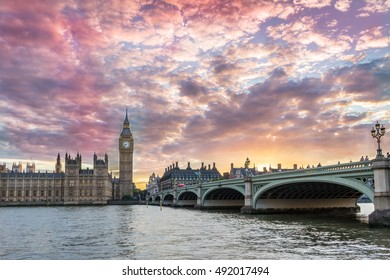 Big Ben and Westminster bridge at pink sunset in London