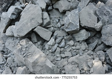 Big black rocks or stones to build foundation, boundary wall in a construction site Kerala, India. Building a house or villa or apartment.