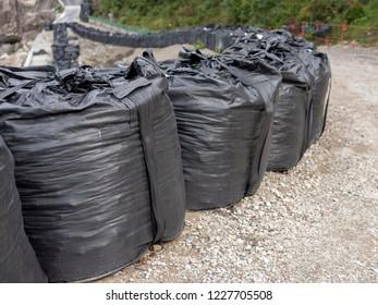 Big black sandbag to prevent landslide, mudslide and flood