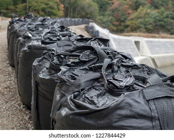 Big black sandbag to prevent landslide, mudslide and flood , close up