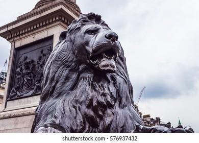 Big black statue of a lion.