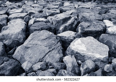 Big black and white stones as a part of the Persian Gulf coastline, background