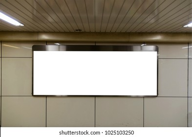 big blank advertising billboard or light box showcase on wall at airport or subway train station, copy space for your text message or media content, advertisement, commercial and marketing concept