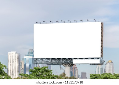 The big blank billboard ready for new advertisement with city view background
