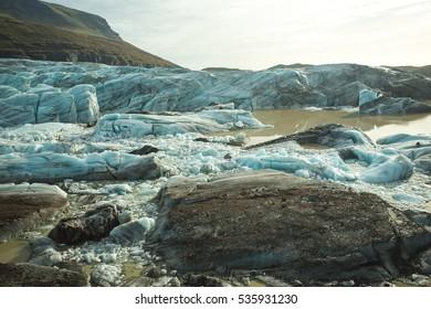 Big blocks of ice loosen from Svinafellsjokul, a glacier in East Iceland. The Svinafellsjokul is one of outlet glaciers of Vatnajokul ice cap. The Svinafellsjokul is accessed by a dirt road.