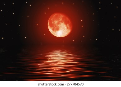 Big bloody red moon and stars reflected in a wavy water surface