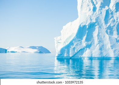 Big blue icebergs in the Ilulissat icefjord, Greenland