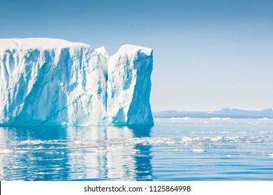 Big blue icebergs in Ilulissat icefjord, western Greenland
