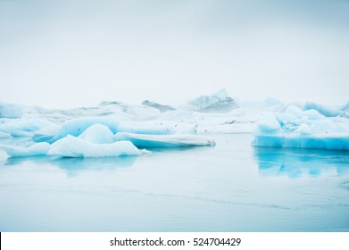 Big blue icebergs in Jokulsarlon glacial lagoon, South Iceland