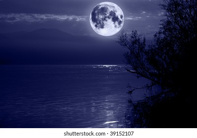 Big blue moon over water. Elements of this image furnished by NASA.
