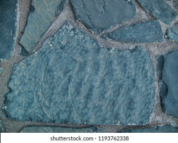 Big blue stone texture background photo. Rough polished brick closeup.  Natural floor material. Irregular stone surface. Distressed stone relief. Rock  wallpaper top view for template or banner.