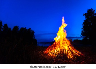 Big bonfire against blue night sky