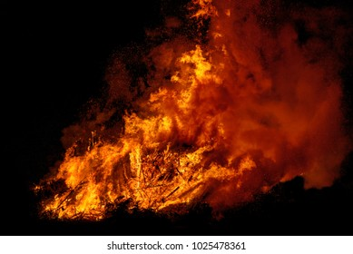 big bonfire with smoke. Flames of a campfire in the night