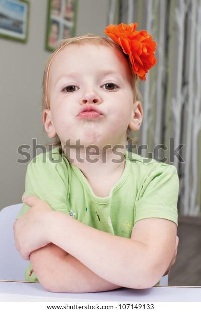 Big Boss Baby Girl Grimacing Stock Photo Edit Now 107149133