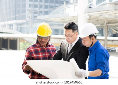 Big boss senior manager briefing, discussion, meeting or safety morning talk plan with engineer, foreman, labor worker before starting build factory, plant, industry project