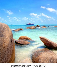 big boulders at the tropical coastline with turqiouse seawater