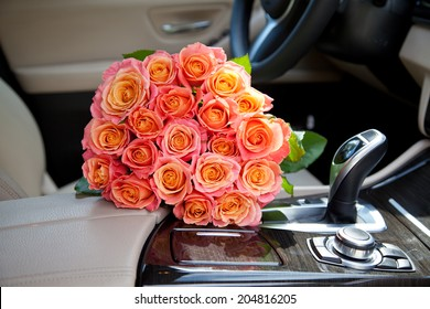 Big bouquet of colorful flower from beautiful fresh pink roses in luxury car. Valentines day romantic