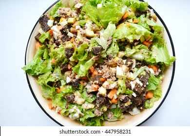 Big bowl of tuna salad with apple and dark bread
