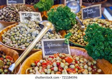 Big bowls of olives on street market