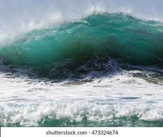 Big breaking wave at Hanakapiai beach, Kauai, Hawaii.