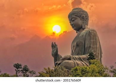 Big bronze Amoghasiddhi Buddha statue called Tian Tan Buddha with sunset sky at Po Lin Monastery Ngong Ping in Lantau Island famous tourist destination in Hong Kong China