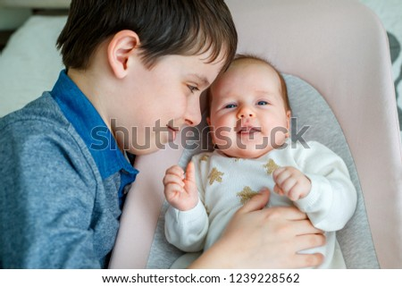03e02057154b Big Brother Hugging His Newborn Baby Stock Photo (Edit Now ...